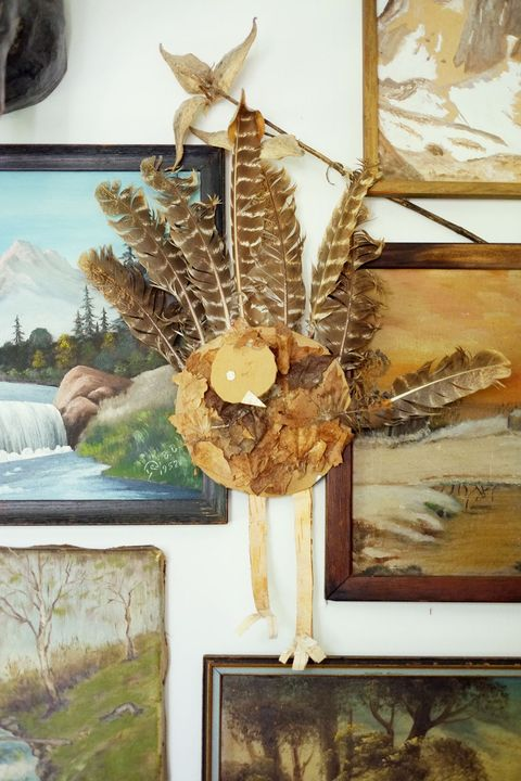Art, Cross, Picture frame, Natural material, Artifact, Symbol, Religious item, Wing, Painting, Art paint,