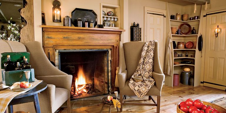 stone slate wood and more get inspired to re do your living room with our favorite fireplace designs and mantel ideas - Decorating Ideas For Living Rooms With Fireplaces