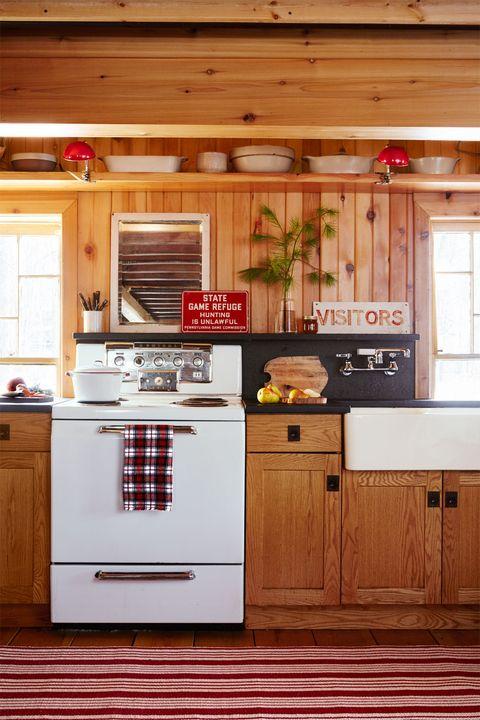 Wood, Room, Floor, Interior design, Property, Wood stain, Hardwood, Red, White, Cupboard,