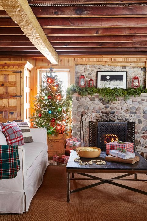 Living room, Room, Home, Interior design, Property, Furniture, Christmas decoration, Tree, House, Table,