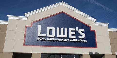 Property, Commercial building, Real estate, Facade, Logo, Font, Majorelle blue, Signage, Gas, Brand,