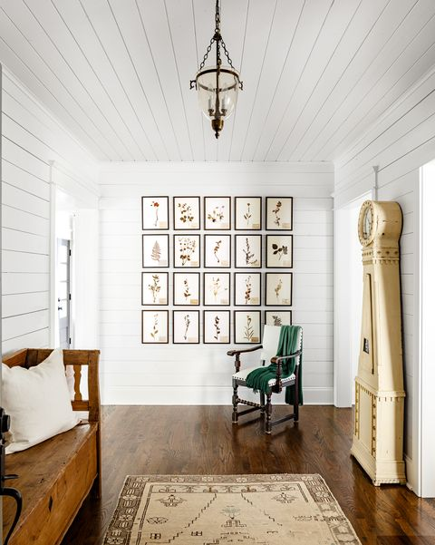 neutral entryway with shiplap walls and ceiling