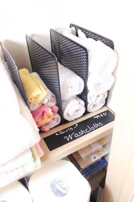 """<p>Who wants to use someone else's dirty cloth? (Yuck.) This clever mom identified different compartments in a file holder for each family member to use post-scrub down.</p><p><a href=""""http://www.realcoake.com/2014/09/linen-closet-organization.html#_a5y_p=2527030"""" target=""""_blank""""><em>See more at The Real Thing With the Coake Family »</em></a></p>"""