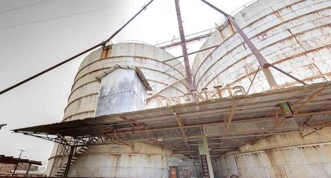 Infrastructure, Silo, Iron, Gas, Storage tank, Composite material, Engineering, Industry, Steel, Cylinder,