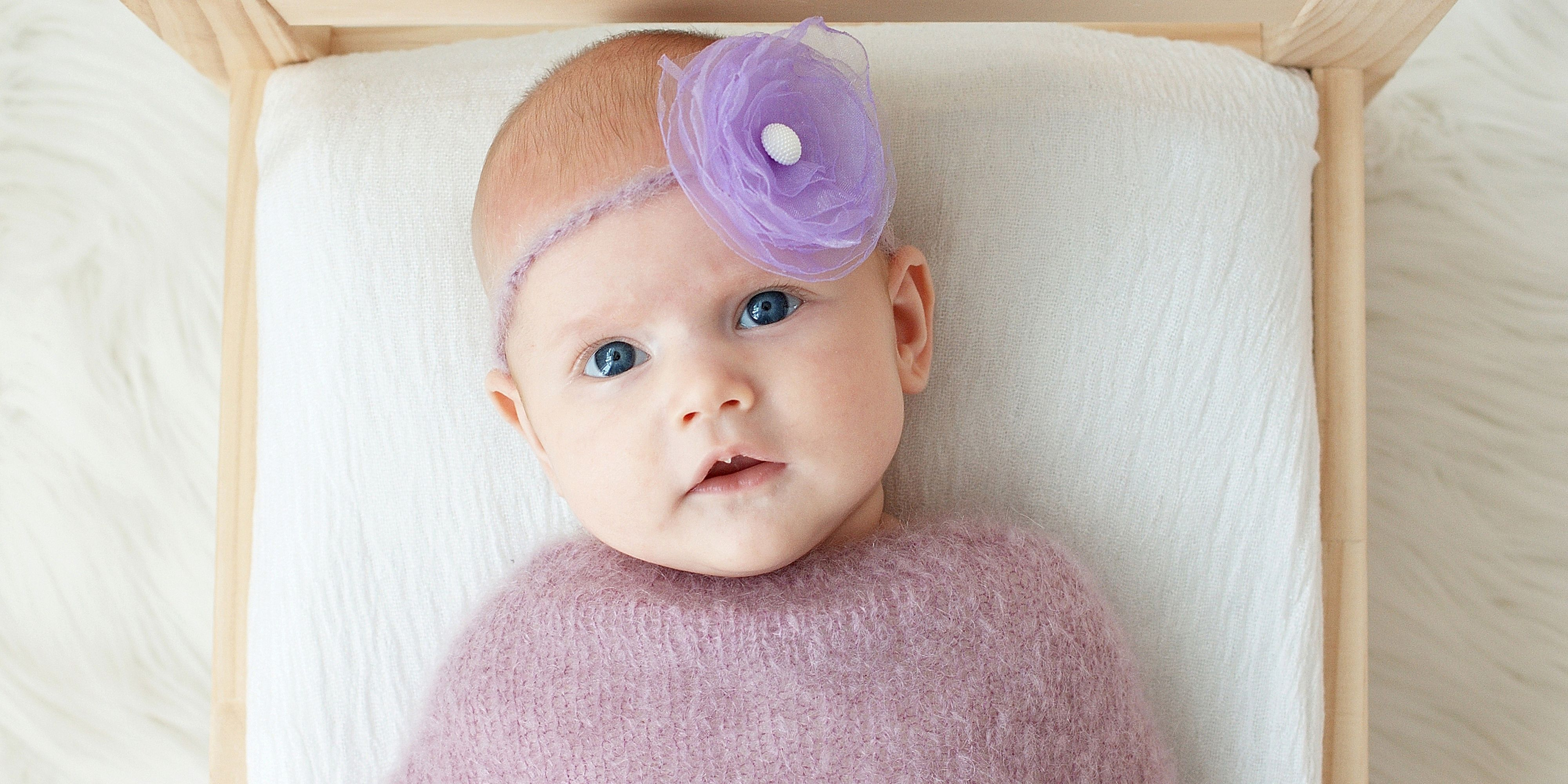 Baby with purple flower headband