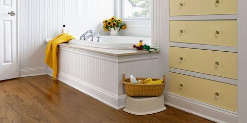 Wood, Yellow, Room, Floor, Flooring, Hardwood, Interior design, Wood flooring, Laminate flooring, Drawer,