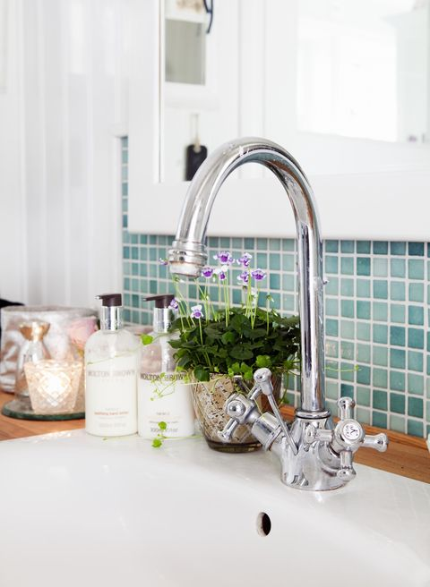 Plumbing fixture, Tap, Sink, Interior design, Peach, Serveware, Plumbing, Glass bottle, Bottle, Ceramic,