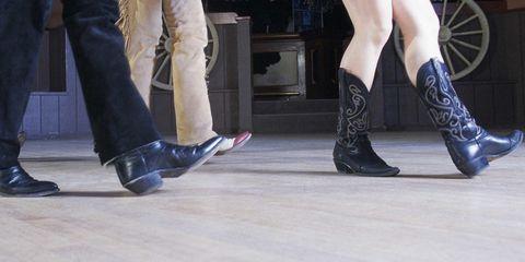 Footwear, Leg, Floor, Human leg, Joint, Outerwear, Flooring, Fashion, Black, Leather,