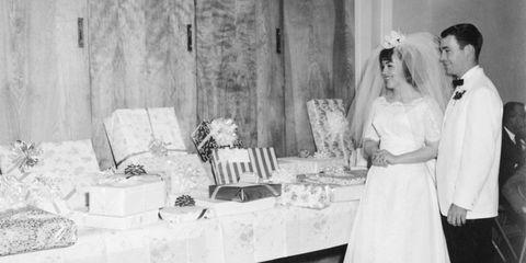 Dress, Bridal veil, Photograph, Bridal clothing, White, Formal wear, Room, Bride, Coat, Veil,