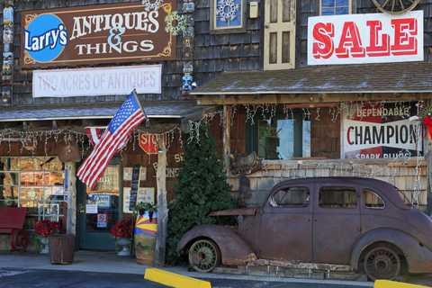 Motor vehicle, Window, Automotive tire, Car, Classic car, Fender, Flag, Vehicle door, Antique car, Signage,