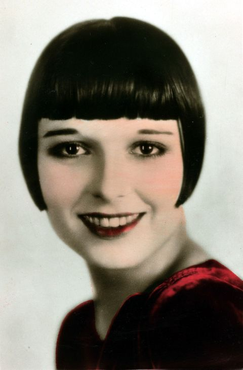 """<p>The total opposite of the era's fluffier looks, <a href=""""http://www.goodhousekeeping.com/beauty/hair/news/g3297/blunt-bangs-trend/"""" target=""""_blank"""">blunt bangs</a> framed the face (and thin '20s brows) in the most literal way possible.</p>"""