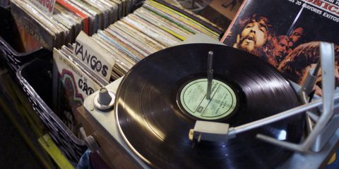 Gramophone record, Publication, Record player, Data storage device, Circle, Book, Album, Electronics,