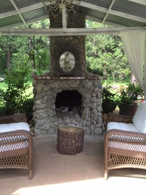 Shade, Fireplace, Curtain, Outdoor furniture, Building material, Outdoor structure, Brick, Wicker, Window treatment, Pergola,