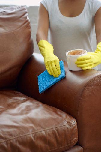 Sleeveless shirt, Tan, Throw pillow, Leather, Plastic, Active tank, Safety glove, Pillow, Glove, Armrest,