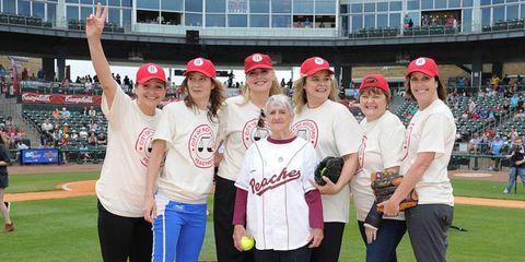 Smile, Sports uniform, Cap, Jersey, Sport venue, Sportswear, Community, Bat-and-ball games, Uniform, Baseball cap,