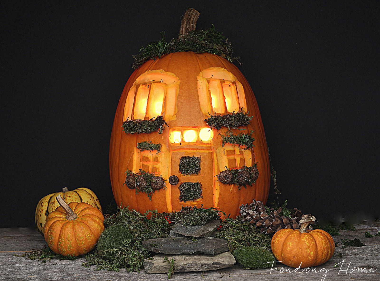 a pumpkin carving of a house