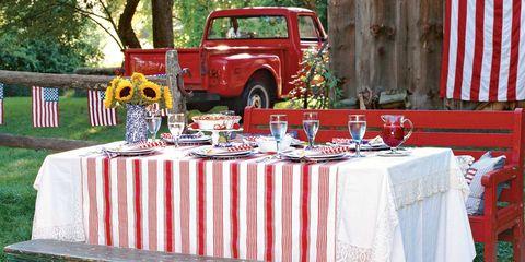 Tablecloth, Textile, Linens, Table, Automotive exterior, Fender, Off-road vehicle, Home accessories, Flag, Auto part,