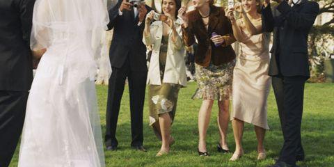Leg, Trousers, Hat, Photograph, Coat, Formal wear, Dress, Interaction, Sun hat, Ceremony,