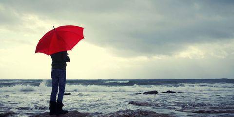 Body of water, Umbrella, Water, Coastal and oceanic landforms, Jeans, Ocean, Fluid, Shore, Sea, Carmine,