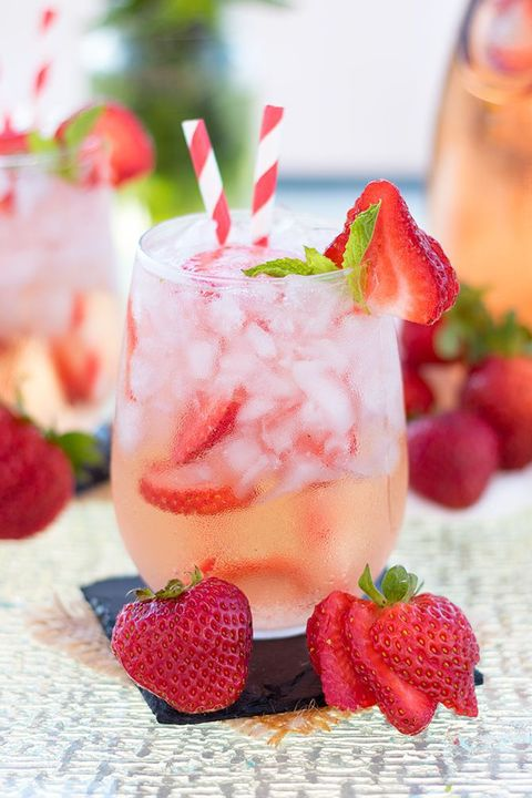 Fruit, Cocktail garnish, Cocktail, Produce, Drink, Liquid, Classic cocktail, Natural foods, Strawberries, Drinking straw,