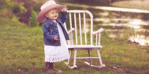 Hat, People in nature, Sitting, Sun hat, Baby & toddler clothing, Spring, Fedora, Outdoor furniture, Vintage clothing, Cowboy hat,