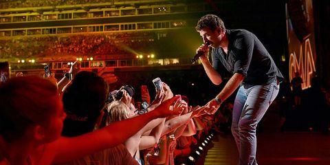 Musician, Music artist, Pop music, Music venue, Fan, Concert, Baseball cap, Bracelet, Singing, Song,