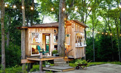Wood, Wheelbarrow, Tree, Cart, Street light, Door, Garden, Log cabin, Outdoor furniture, Yard,