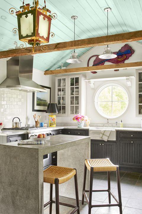Interior design, Room, Wall, Table, Interior design, Grey, Light fixture, Countertop, Paint, Stool,