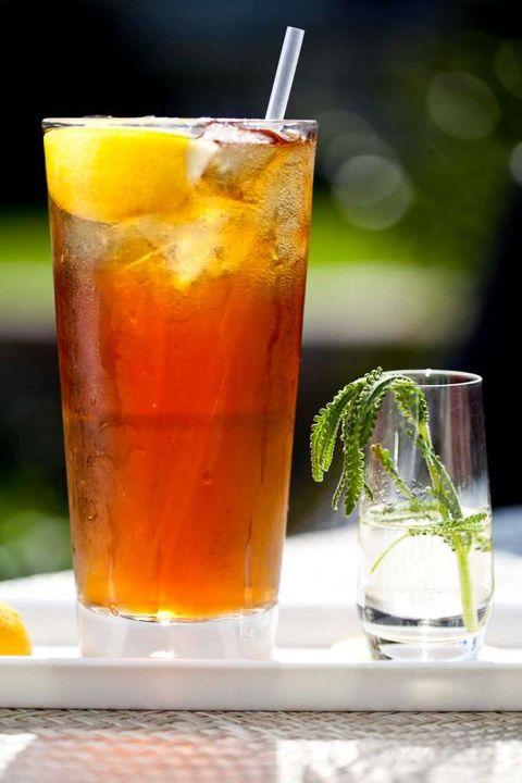 Liquid, Drink, Alcoholic beverage, Glass, Orange, Classic cocktail, Cocktail, Amber, Drinkware, Fluid,