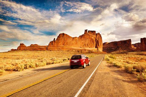 Road, Mountainous landforms, Automotive tail & brake light, Cloud, Infrastructure, Natural landscape, Landscape, Plateau, Highland, Automotive lighting,