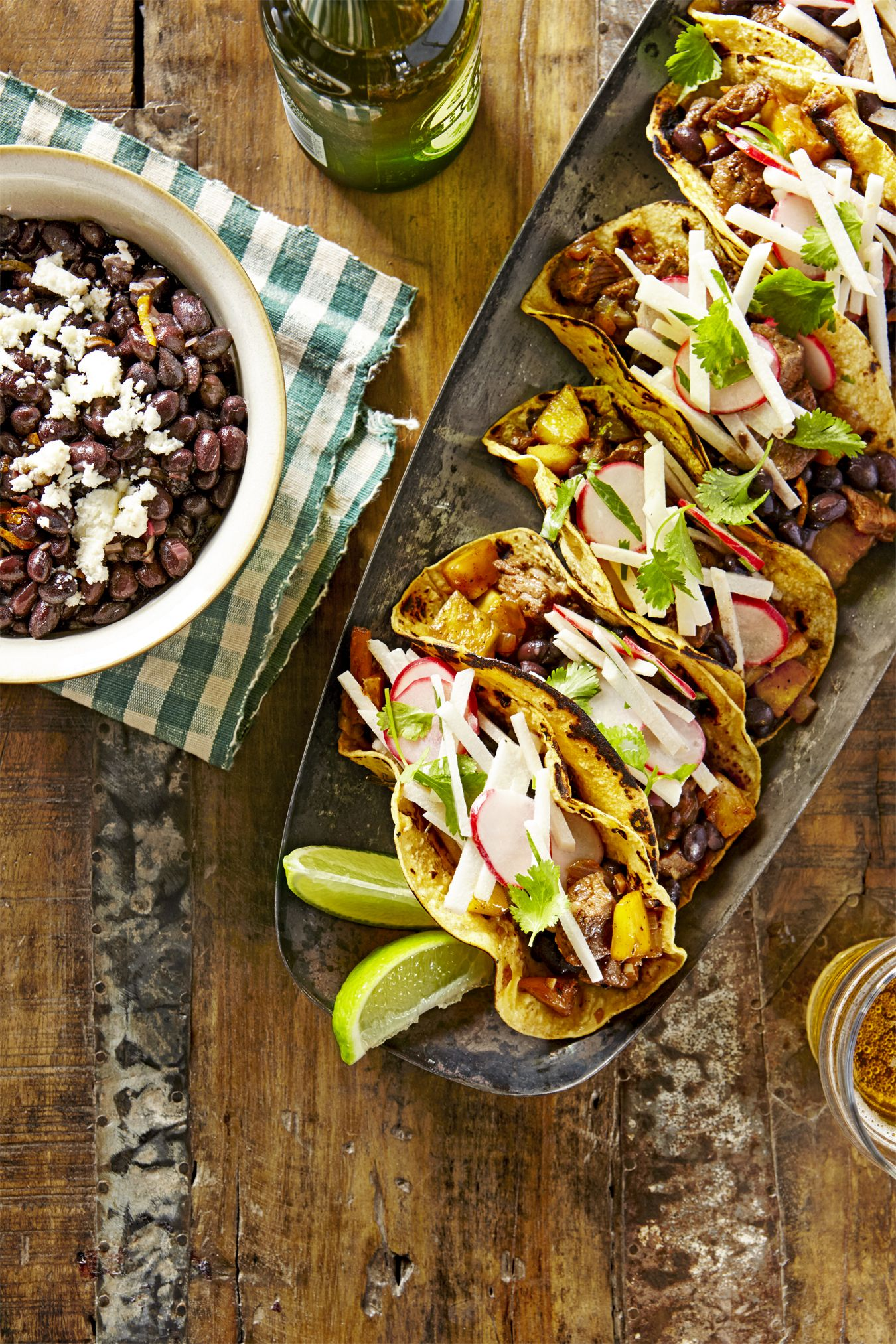 beef and pineapple tacos with mojo beans