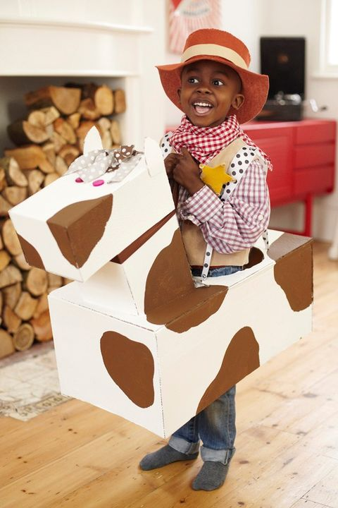 child, toddler, headgear, cowboy hat, hat, fashion accessory, table, sun hat, paper bag, play,