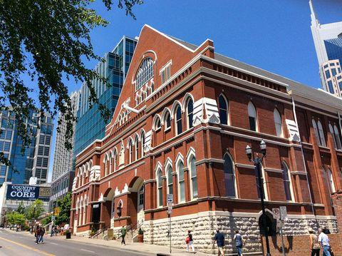 Clothing, Window, Road, Facade, Building, Mixed-use, Town, Street, Landmark, Pedestrian,