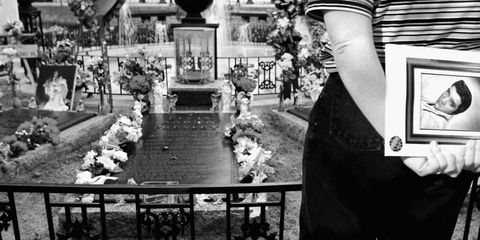 Human, White, Monochrome, Monochrome photography, Picture frame, Black-and-white, Flower Arranging, Fence, Floral design, Rose,