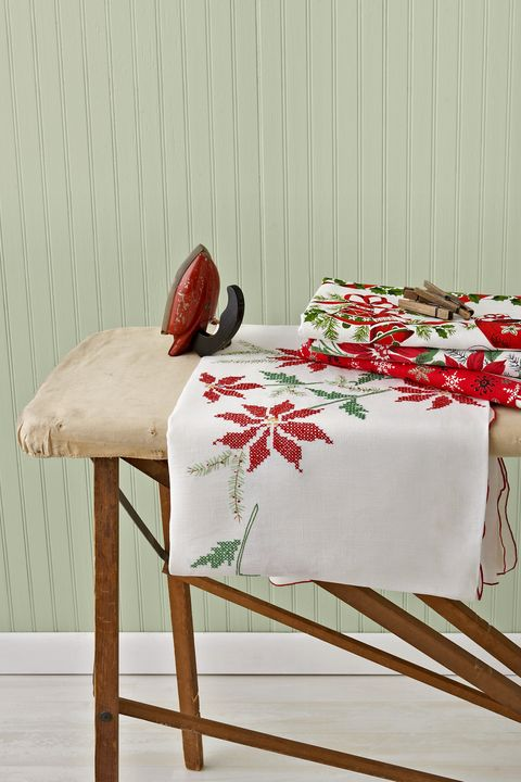 Furniture, Table, Tablecloth, Textile, Linens, Home accessories, Interior design, Room, Rectangle, Plant,