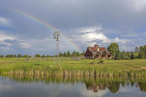 Natural landscape, Cloud, Water resources, Reflection, Rainbow, Landscape, Wetland, Bank, Rural area, Land lot,