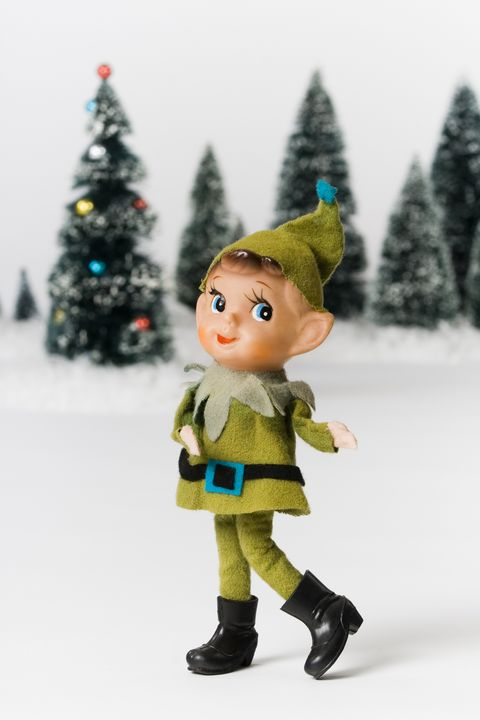 Winter, Green, Toy, Fictional character, Holiday, Costume accessory, Evergreen, Knee, Christmas decoration, Christmas tree,