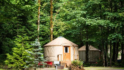 "<p>""Peace of mind"" and ""Oregon"" go hand-in-hand, but beyond picturesque hiking at Crater Lake and cruising along Portland's revered biking trails, Oregon is also home to some of the best camping in the world. Leave your phone charger — iPad, laptop, and speaker too — at home and cozy up at this <a href=""https://www.rvonthego.com/""><u data-redactor-tag=""u"">Thousand Trails and Encore</u></a> campground that's open year-round (some northwestern sites close for the winter). No RV required; pick your sanctuary: cabins, cottages, yurts, or an 170-square-foot <a href=""http://www.countryliving.com/life/travel/g3595/tour-tiny-house-village/"" target=""_blank""><u data-tracking-id=""recirc-text-link"" data-redactor-tag=""u"">tiny home</u></a> and immerse yourself in the best nature has to offer. Try hiking on one of 700 groomed trails, bird watching, rock climbing, or simply meditating by the tranquil calm of a lake or stream. P.S. Restore weary limbs at the club house's hot tub. </p><p><em data-redactor-tag=""em"">For more information, visit </em><a href=""http://www.rvonthego.com/oregon/mt-hood-village-rv-resort/""><em data-redactor-tag=""em"">rvonthego.com/oregon/mt-hood-village-rv-resort/</em></a><em data-redactor-tag=""em"">.</em></p>"