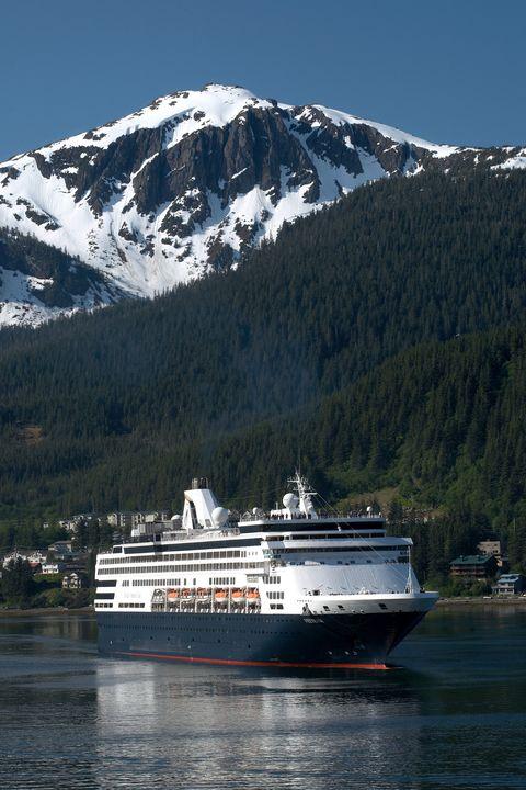 Mountainous landforms, Water, Watercraft, Boat, Mountain range, Cruise ship, Passenger ship, Waterway, Mountain, Liquid,