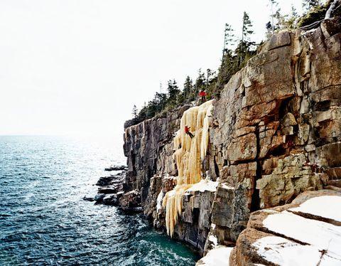 Body of water, Coastal and oceanic landforms, Coast, Rock, Ocean, Bedrock, Fluid, Sea, Stone wall, Terrain,