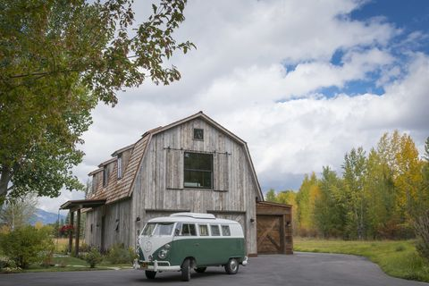 this guest house was built to look like a rustic barn - rustic barn