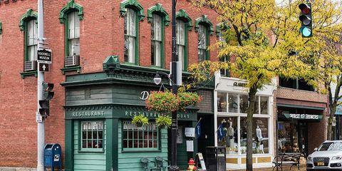 Window, Neighbourhood, Automotive parking light, Town, Street, Brick, Sidewalk, Mixed-use, Door, Street light,