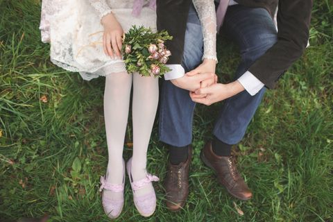 Married couple with bouquet of flowers