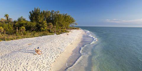 Body of water, Beach, Shore, Sea, Coast, Sky, Ocean, Natural environment, Sand, Coastal and oceanic landforms,