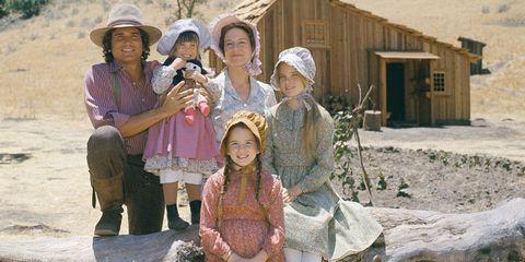 Human, Hat, Rural area, Sun hat, Village, House, Boot, Shack, Human settlement, Hut,