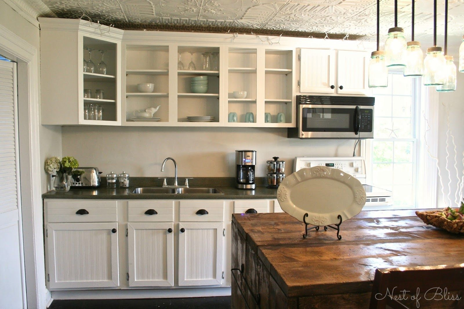 10 DIY Kitchen Cabinet Makeovers Before
