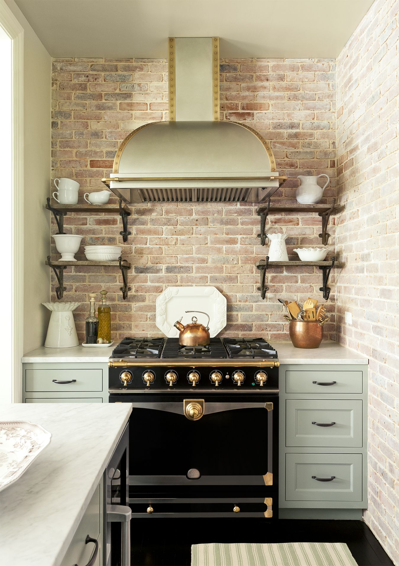 Black Appliances. Emily Gilbert. Brick Backsplash