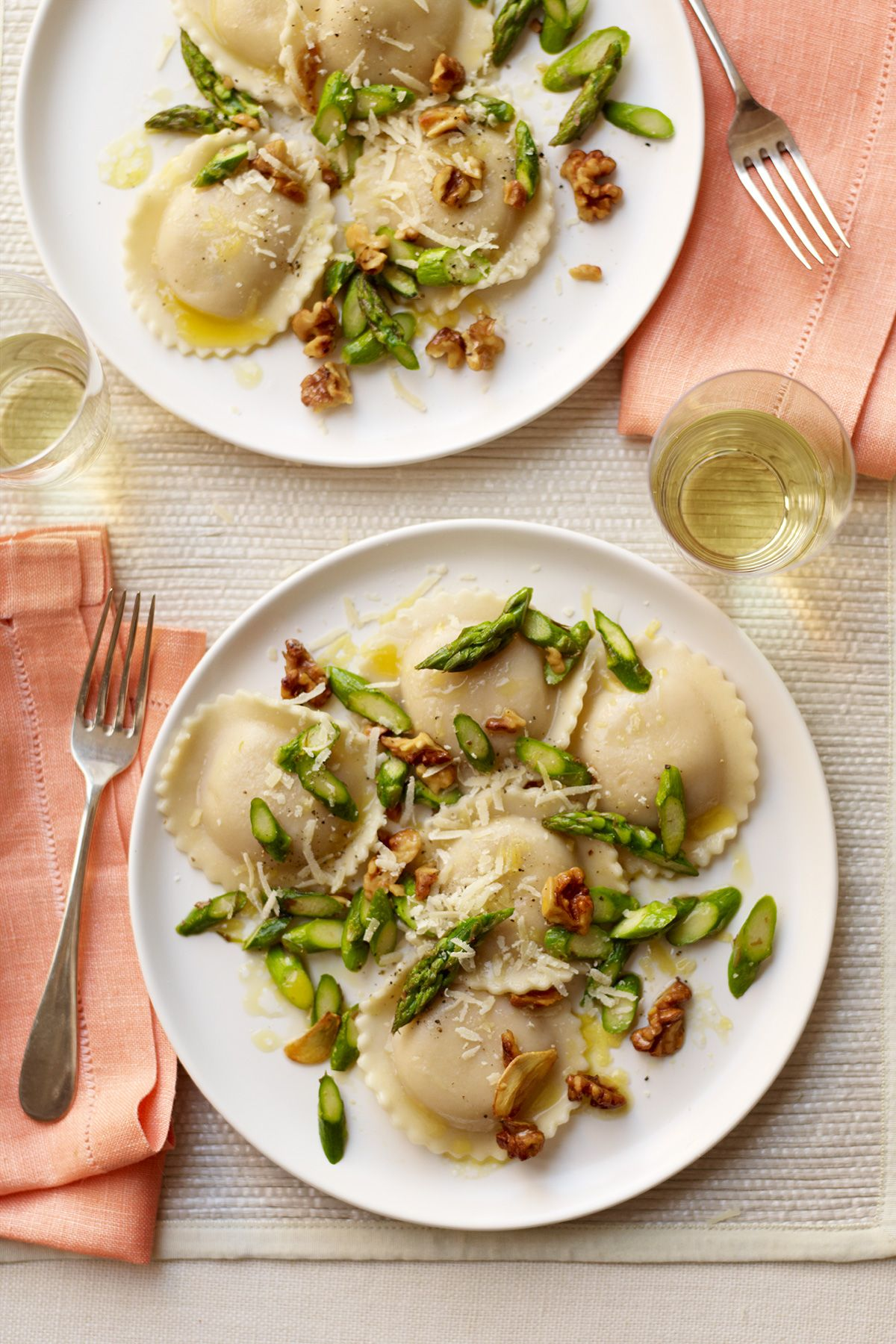 ravioli with sautéed asparagus and walnuts