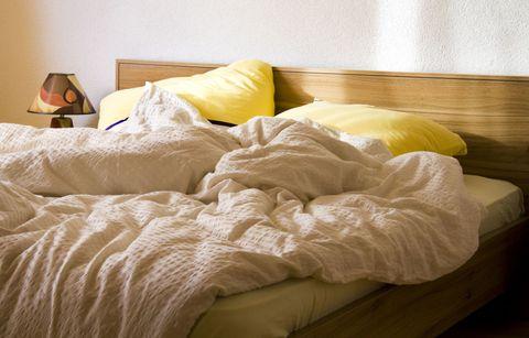 Cozy unmade bed