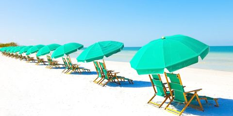 Umbrella, Sunlounger, Outdoor furniture, Turquoise, Folding chair, Table, Beach, Leisure, Shade, Furniture,